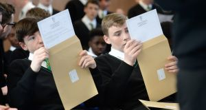 RESULTS DAY: Adam Dowling and Lee Cassin receive their Junior Cert results, at St Kevin's College, Ballygall Road, Finglas, Co Dublin. Photograph: Dara Mac Dónaill/The Irish Times