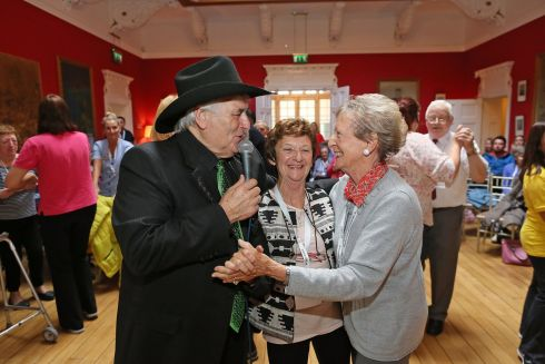 SONG AND DANCE: TR Dallas dances with Patrica Carroll and Ann McCullough at a tea party for residents and staff at Middletown House, Co Wexford. Photograph: Julien Behal Photography