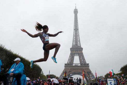 TOWER OVER THE COMPETITION: French athlete Antoinette Nana Djimou jumps in front of the Eiffel Tower during the Fly Europe Paris. Photograph: Gonzalo Fuentes/Reuters