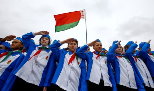 BELARUS COMMEMORATION: Belarusian schoolchildren salute during celebrations in Minsk marking the 27th-anniversary of the country's Young Pioneer movement. Photograph: Vasily Fedosenko/Reuters
