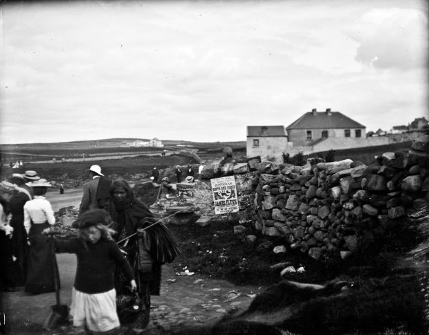 "Beside the seaside – Holidaymakers at Bundoran, Co Donegal. ""We all wondered about this south Asian woman in Donegal, and had our fingers crossed for a great story."" Unfortunately, this mystery so far remains unsolved. Photograph: John J Clarke (1879-1961)"