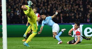Manchester City striker Sergio Agüero scores his side's second goal during the  Champions League match against Feyenoord  in Rotterdam. Photograph: Emmanuel Dunand/AFP/Getty Images