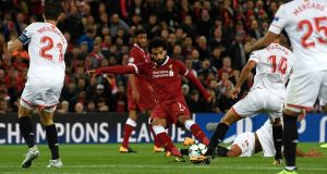 Mohamed Salah scores  Liverpool's  second goal during the  Champions League  match against Sevilla  at Anfield. Photograph:  Stu Forster/Getty Images