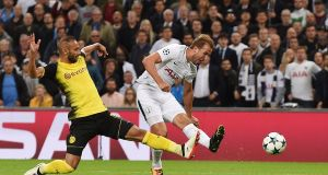 Tottenham's Harry Kane  scores his side's second goal in the  Champions League  match against  Borussia Dortmund at Wembley Stadium. Photograph: Andy Rain/EPA