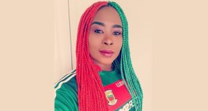 Kany Kazadi's screaming red and green hair braids have jumped off her Twitter page and rustled up a stor. Photograph: Kany Kazadi/Twitter