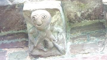 A Sheela na Gig on the exterior of a church in Kilpeck, UK
