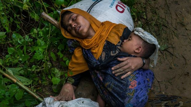 Shamsu Nahar, a Rohingya refugee, collapses with exhaustion and chest pains after crossing the border illegally near Amtoli, Bangladesh, on August 31st. Photograph: Adam Dean/New York Times