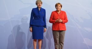 German Chancellor Angela Merkel greets Britain's Prime Minister Theresa May prior to the start of the G20 meeting in Hamburg, on July 7, 2017.  BERND VON JUTRCZENKA/AFP/Getty Images