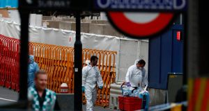 Police forensics officers work at London Bridge in London on June 4th, 2017, after the terror attack on the bridge and at the nearby Borough Market the previous night in which seven people were killed. Photograph: Odd Andersen/AFP/Getty Images