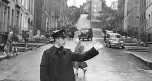 Garda Dick O'Connor, on point duty  at the McCurtain Street-Bridge Street crossing in Cork in 1954