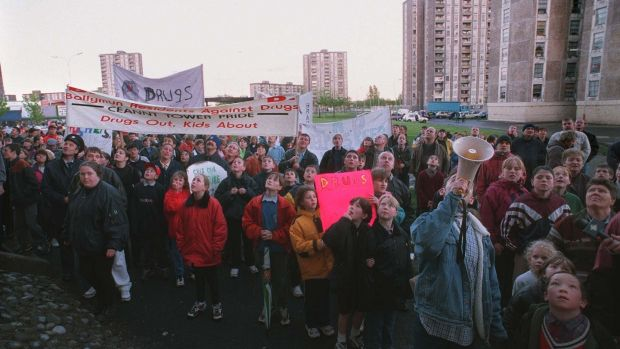 NEWS...... PEOPLE TAKING PART IN A ANTI-DRUGS RALLY, ORGANISED BY BALLYMUN RESIDENTS AGAINST DRUGS, CHANT SLOGANS IN A VERBAL EXCHANGE WITH A RESIDENT OF ONE OF THE TOWER BLOCKS, IN BALLYMUN LAST NIGHT. PHOTOGRAPH: ERIC LUKE.