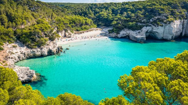 Get some last-minute sun at Cala Mitjana beach in Menorca