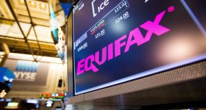 Data breach: A monitor displays Equifax signage on the floor of the New York Stock Exchange (NYSE). Photograph: Michael Nagle/Bloomberg