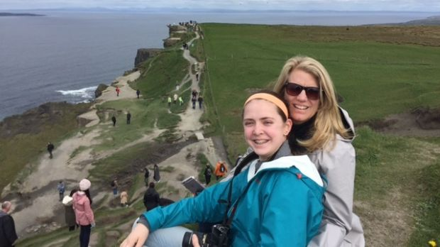US visitors Emily and Mary Brouder, who were hosted by Owen Mangan, at the Cliffs of Moher.