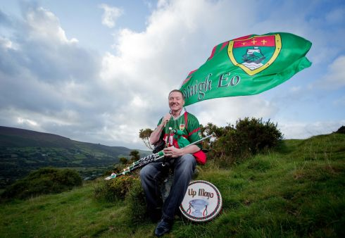 PIPE UP: Mayo football fan and world champion uilleann piper Eamonn Walsh pictured in the Dublin Mountains. Photograph: Tom Honan