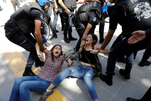 TURKEY UNREST: Riot police detain protesters outside a courthouse in Ankara, Turkey, during the trial of two teachers. Photograph: Umit Bektas/Reuters