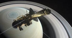 Nasa's Cassini above Saturn's northern hemisphere prior to making one of its last dives.  Photograph: Nasa/PA