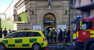Emergency services attend the scene following a blast on an underground train at Parsons Green tube station in West London on Friday. Photograph:  Twitter: @ASolopovas/Reuters