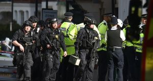 Armed police close to Parsons Green station in west London after an explosion on Friday. Photograph: Dominic Lipinski/PA Wire