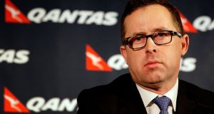 Qantas chief executive Alan Joyce has seen his pay packet almost double in the latest financial year. Photograph: Lisa Maree Williams/Getty Images