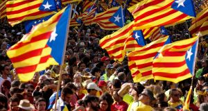 "People wave ""Esteladas"" (pro-independence Catalan flags) in Barcelona on the national day of Catalonia, the ""Diada"", on September 11th. Photograph:  Pau Barrena/AFP/Getty Images"