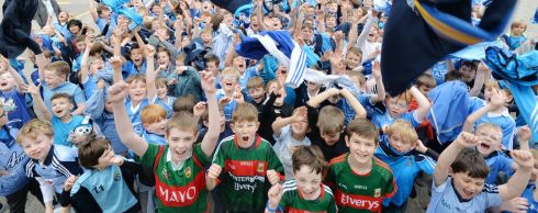 FACE-OFF: Mayo-supporting pupils from Scoil Mhuire CBS, Griffith Avenue, Dublin, who have family in Mayo - Stephen Murphy, Ruairi Kernan, Tomas Thornton and Oran Malone - surrounded by Dublin-supporting pupils ahead of the All-Ireland football final between Dublin and Mayo. Photograph: Alan Betson/The Irish Times
