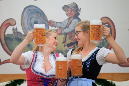 BEERFEST: Barmaids Greta Brodersen and Julika Busch at beer festival Oktoberfest, which has returned to its Irish home at George's Dock, Dublin. Photograph: Nick Bradshaw