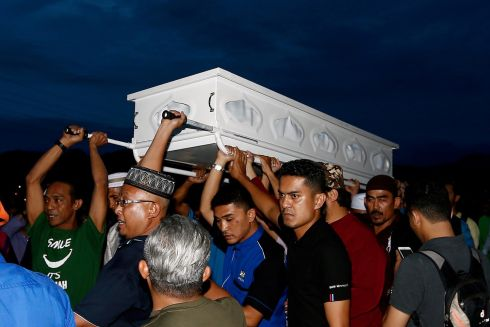 FIRE VICTIM: People carry a casket with the body of a victim of a fire at the Darul Quran Ittifaqiyah religious school during a funeral in Kuala Lumpur, Malaysia. Photograph: Lai Seng Sin/Reuters