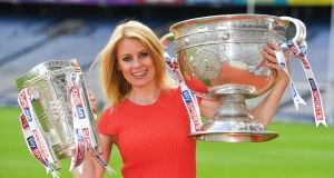 Rachel Wyse with the Liam Mac Carthy and Sam Maguire Cups.