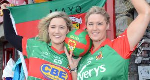 Twins Clara  and Maria Harrington from  Westport flying the flag for Mayo ahead of Sunday's All-Ireland football final against Dublin. Photograph:  Paul Mealey