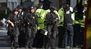 Armed officers at Parsons Green: London mayor Sadiq Khan has called for more police resources. Photograph: Dominic Lipinski/PA Wire