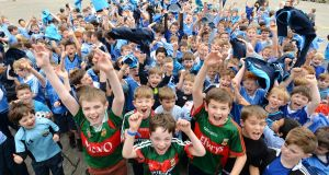 Mayo supporting pupils from Scoil Mhuire NS, Stephen Murphy, Ruairí Kernan, Tomás Thornton and Oran Malone surrounded by fellow Dublin supporting pupils on the eve of the All-Ireland football final between Dublin and Mayo. Photograph: Alan Betson