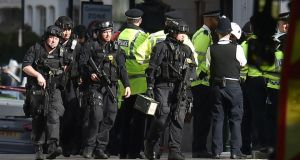 London manhunt: armed police near Parsons Green after Friday's explosion. Photograph: Dominic Lipinski/PA Wire