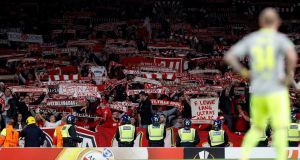 Cologne's supporters raise their scarves in the crowd during the Europa League Group match against  Arsenal  at the Emirates Stadium in London. Photograph: Adrian Dennis/AFP/Getty Images