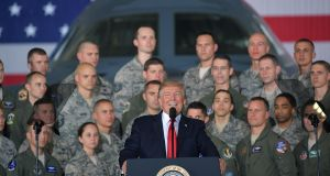 US president Donald Trump speaks to members of the military at Joint Base Andrews, in Maryland. Photograph: Mandel Ngan/AFP/Getty Images