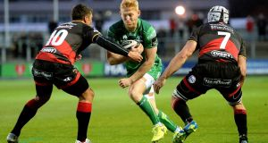 Connacht's Rory Scholes is tackled by  Gavin Henson of the Dragons during the Guinness Pro 14 game  at Rodney Parade. Photograph: Ian Cook/Inpho