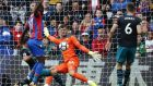 Southampton goalkeeper Fraser Forster saves a shot from Crystal Palace striker Christian Benteke. Photograph: Getty Images