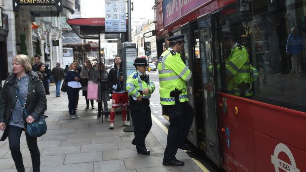 "Police patrol a London bus on Saturday after the terror level was increased to ""critical"" following a terrorist attack in Parson's Green Underground station, London. Photograph: Facundo Arrizabalaga/EPA"