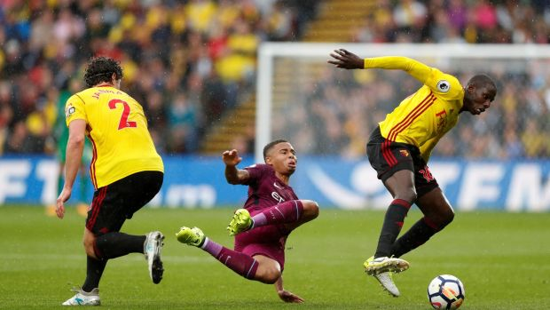 Watford's Daryl Janmaat and Abdoulaye Doucoure in action with Manchester City's Gabriel at Vicarage Road. Photograph: John Sibley/Reuters