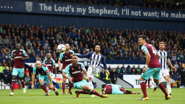 Matt Phillips of West Bromwich Albion gets his shot away against West Ham. Photograph: Michael Steele/Getty Images