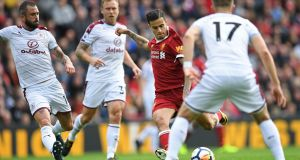 Liverpool's Philippe Coutinho takes a shot during the draw with Burnley at Anfield. Photograph: Getty Images