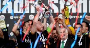 Dundalk's Chris Shields lifts The EA Sports Cup. Photograph: Ryan Byrne/Inpho