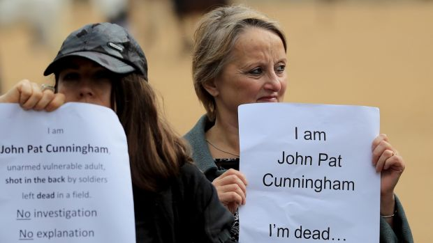 Supporters of John Pat Cunningham hold a counter-protest, as supporters of former British soldier Dennis Hutchings march in London. Photograph: Gareth Fuller/PA Wire