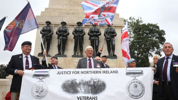 Former British soldier Dennis Hutchings (centre), who has been charged over the fatal 1974 shooting of a man in Northern Ireland, takes part in a protest to call for an end to prosecutions of veterans who served during the Troubles, on Horse Guards Parade, London. Photograph: Gareth Fuller/PA Wire