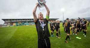 Dundalk's Chris Shields celebrating with the EA Sports Cup at Tallaght Stadium. Photograph: Ryan Byrne/Inpho