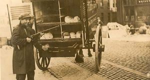 A bread cart with armed fighters in the Irish Civil War, around 1922: We can never know for sure if Protestants were targeted out of pure religious hatred or selected as convenient symbols of the old coloniser, Britain. Photograph: National Library of Ireland
