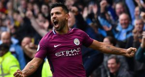 Manchester City's Sergio Aguero celebrates scoring his third and his team's fifth goal against Watford. Photograph: Getty Images