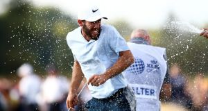 Romain Wattel of France is sprayed with champagne on the 18th green after winning the KLM Open at The Dutch  in Spijk, Netherlands. Photograph: Dean Mouhtaropoulos/Getty Images