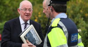 Minster for Justice Charlie Flanagan speaking to a garda at Hotel Minella, Clonmel, where the Fine Gael think-in was taking place at the weekend ahead of the resumption of the Dáil next week. Photograph: Brian Lawless/PA Wire