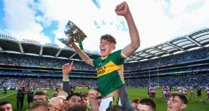 Kerry captain  David Clifford celebrates with the trophy and his team-mates after the All-Ireland minor football championship win over Derry at Croke Park. Photograph:  Tommy Dickson/Inpho